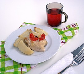 Chicken baked with potatoes and tomatoes