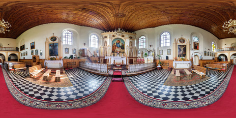 Panorama interior of basilica near the organ with view of the altar.  Full spherical 360 by 180 degrees seamless panorama in equirectangular projection. VR content