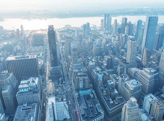 Wall Mural - NEW YORK CITY - JUNE 9, 2013: Night aerial view of Midtown skyscrapers. New York attracts 50 million tourists every year