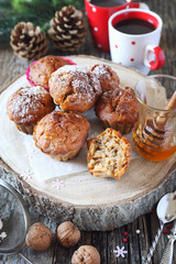 New Year mood: spiced honey muffins with walnuts, two cups of coffee and pine cones