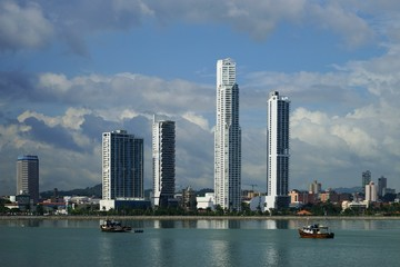 Day view of Panama City Over Panama Bay with fishing boats on the foreground