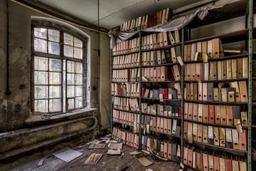 old rotting folders in shelf