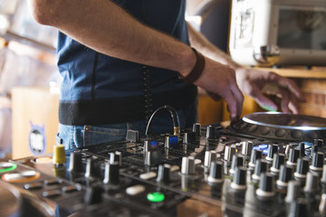 DJ plays at home