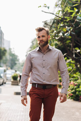 Handsome Man With Beard and Mustache Walking Down the Street