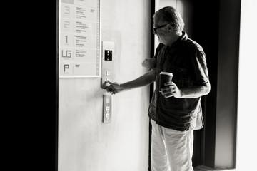 Senior Man Waiting for the Elevator