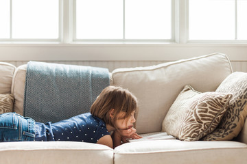 8 year old reading on the sofa