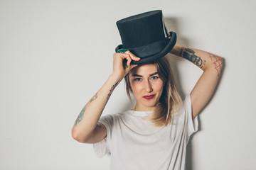 Portrait of a beautiful woman with a top hat