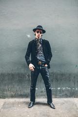 Elegant young bohemian man in urban setting
