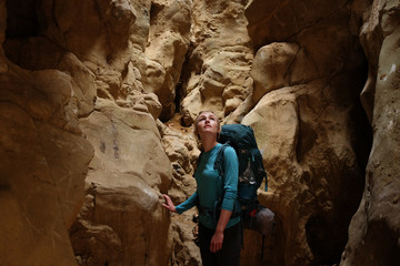 A female backpacker exploring cave