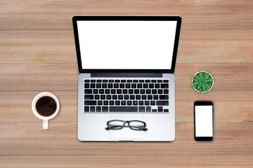 Top view, Flat lay style, Travel set, Working desk, computer, laptop, smart phone, coffee, mug, on wooden color with textured background with clipping path.