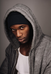African male model  in urban style on grey background.
