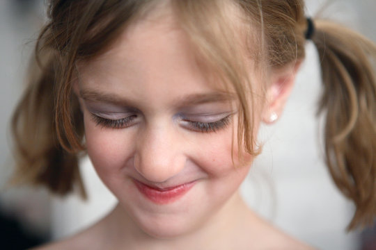 Girl With Pig Tails And Make Up Smiling