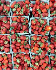 Baskets of fresh strawberry fruit at farmer's market