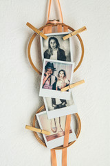 photos pegged onto embroidery hoops with ribbons