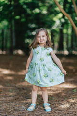 Portrait of an adorable young girl in a summer dress