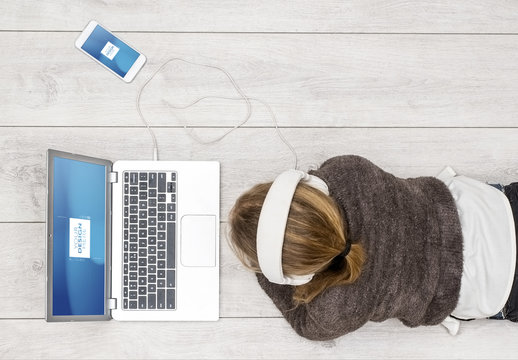 Laptop User with Headphones and Smartphone Mockup 1
