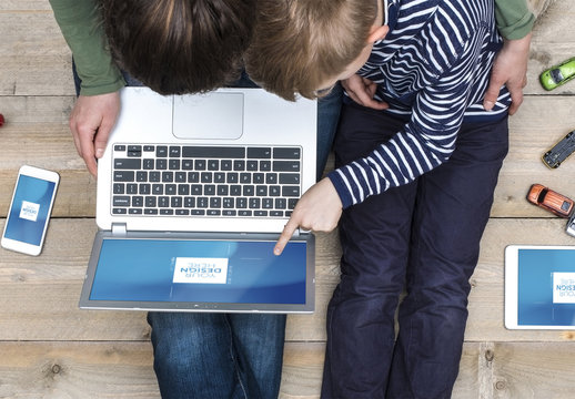 Top View Mockup of Mother and Son with Laptop, Tablet and Smartphone