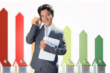Composite image of confident estate agent standing at front door