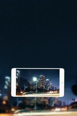 Night city on mobile phone screen
