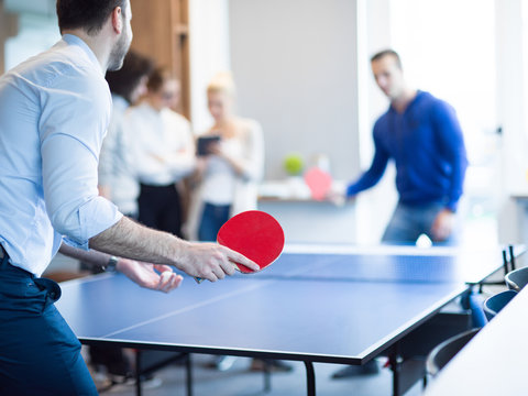 startup business team playing ping pong tennis