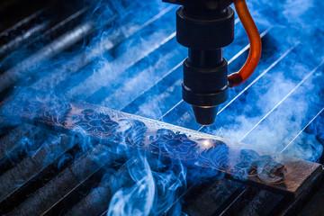 Laser makes engraving on leather belt
