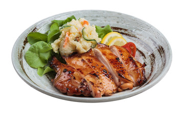 Isolated Teriyaki chicken served with potato salad, sliced lemon, totmato and green oak in round stone plate.