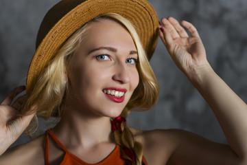 blond girl in  hat