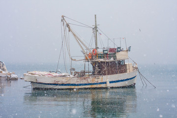 A fishing boat in the snow