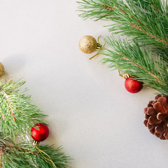 Christmas background with copy space, fir tree branches and balls