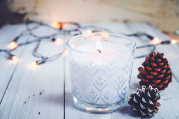 Wall Mural - Christmas background - Christmas candle and rustic decoration on wood table with christmas lights background in night party. vintage color style.