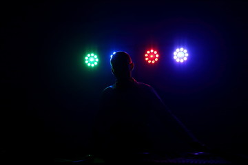 DJ in the light of the floodlights.