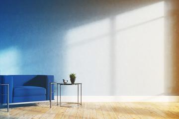 Minimalistic living room, blue armchair toned