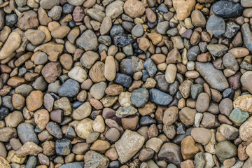 Road of multi-colored stones of a round shape background image