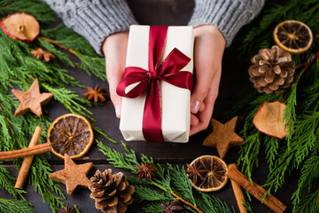 Woman hands making Christmas day gifts.
