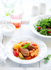 Thick soup of meatballs with vegetables.
