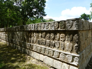 Chichen Itza, heads of the dead in stone wall of the Maya, Yucatan (Mexico)