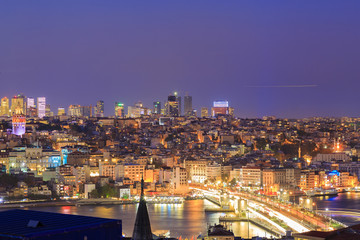 Istanbul view from down town of the city during the twilight with beatiful atmospheric blue sky and city lights