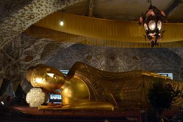 A temple housing one golden reclining Buddha statue