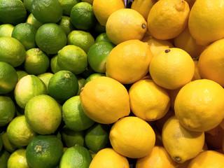 Fototapeta Green and Yellow Lemons Background
