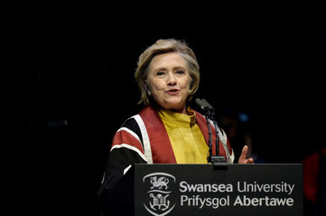Former U.S. Secretary of State, Hillary Clinton, gives the Honorary Degree Recipient Address after receiving an Honorary Doctorate of Law at Swansea University, in Swansea