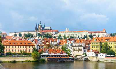 Prague Castle. The Charles Bridge. Medieval fortress. The Vltava River. Red tiled roofs. View from Charles Bridge