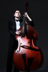 Tuinposter Muziek Double bass player contrabass. Classical musician jazz bass