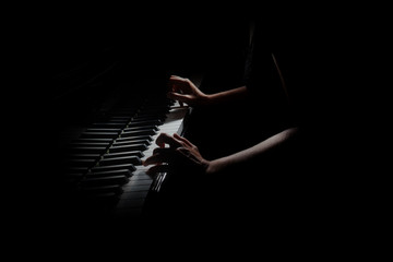 Fotorollo Musik Piano player. Pianist hands playing grand piano