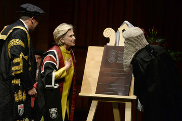 Former U.S. Secretary of State, Hillary Clinton, unveils a plaque to mark the opening of the Hillary Rodham Clinton School of Law after receiving an honorary degree at Swansea University, in Swansea