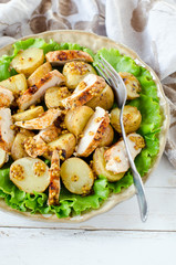 Warm salad of chicken and potatoes with mustard dressing