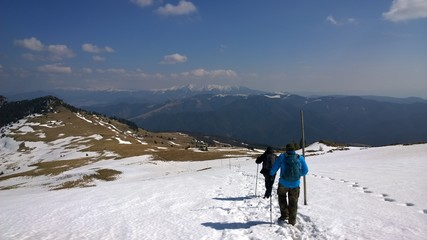 Hiking men on mountains in snow during winter. Slovakia