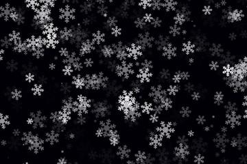 Copos de nieve blancos sobre fondo negro.