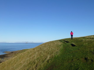 Beautiful landscape on the Isle of Sky in Scotland with a wandering girl 2