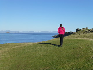Beautiful landscape on the Isle of Sky in Scotland with a wandering girl 1