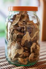 Dried mushrooms in glass jar